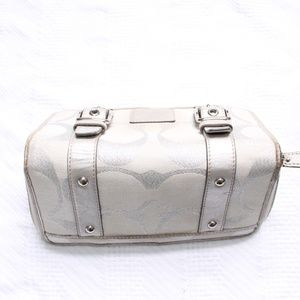 Coach Bags - Coach Silver Canvas Zip Around Buckle Wallet
